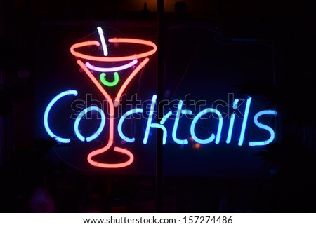 A blue and red neon sign reading Cocktails - stock photo