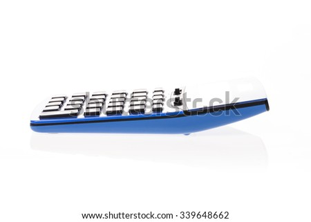 A blue calculator side view isolated white. - stock photo