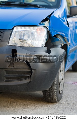 A blue car with a front damage