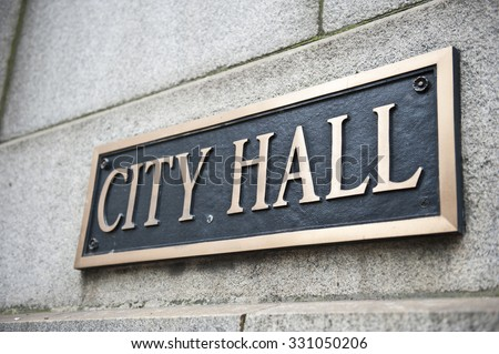 A blue colored plaque mentioning City Hall attached to the wall of the Chicago City Hall and County Building in Chicago, Illinois. It is one of the oldest buildings in the city. - stock photo