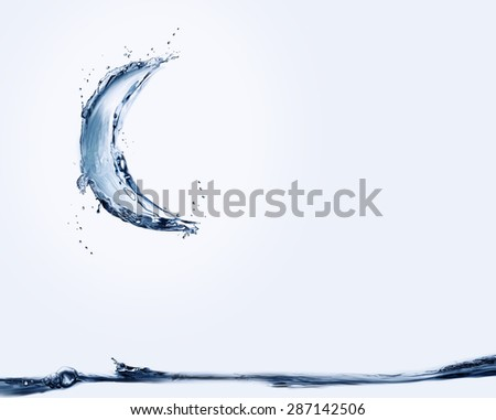 A blue crescent made of water shining over water. - stock photo