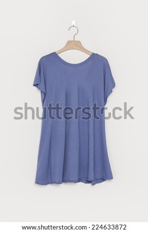 A blue empty blouse back side with wooden hanger isolated white background. - stock photo