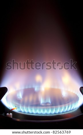 a blue gas flame in extreme closeup - stock photo