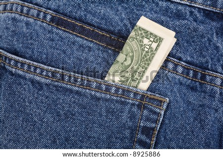 a blue jean and dollars close up shot