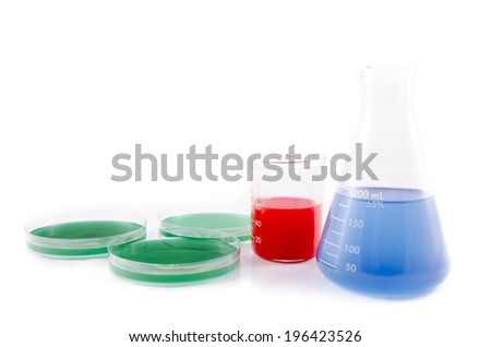 A blue liquid in an erlenmeyer flask and test tube isolated on a white background. - stock photo