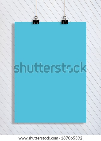 a blue list of paper on the white wooden wall