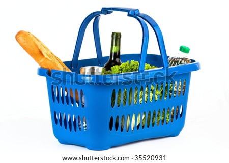 A blue plastic shopping basket on a white background filled with products. - stock photo