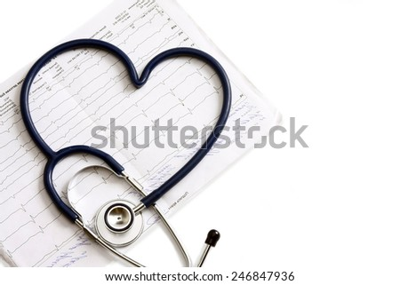 A blue statoscope in the shape of a heart on a  cardiogram - stock photo