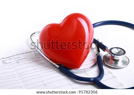 A blue stethoscope on a cardiogram - stock photo