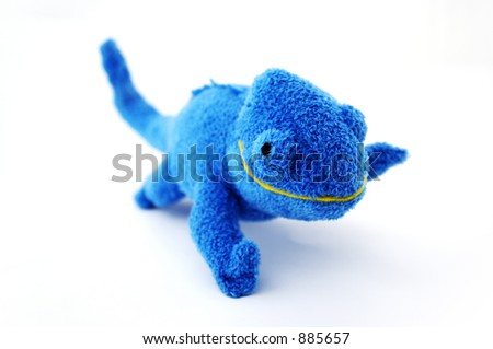 A blue stuffed animal lizard.