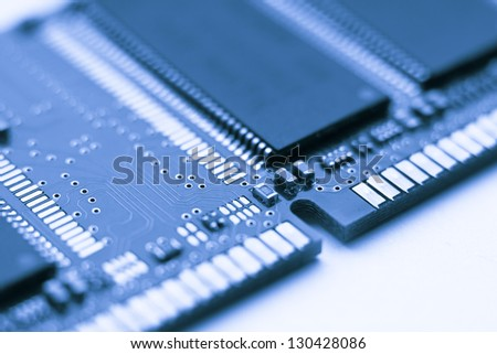 A blue tone close up of a circuit board from a computer - stock photo