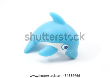 A blue toy dolphin - stock photo