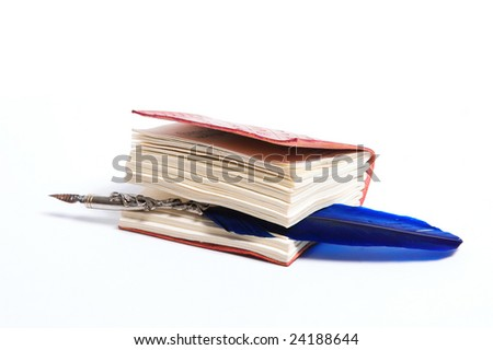 A blue writing feather into a diary on a white background