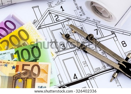 a blueprint of an architect with euro money. symbolic photo for financing and planning of a new house. - stock photo
