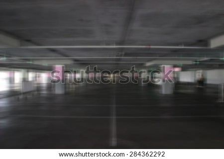 a blur photo of the empty parking lot in one shopping center in Thailand