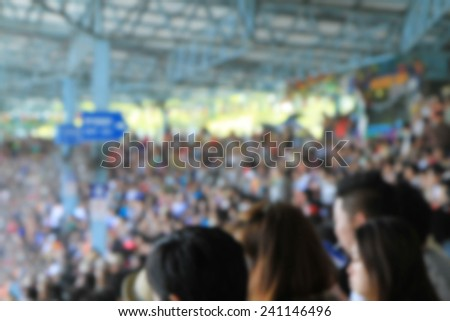 A blurred Asian crowd in a stadium  - stock photo