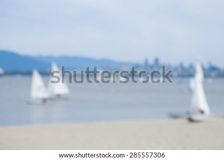a blurred background of Jericho Beach with Vancouver Canada in the background - stock photo