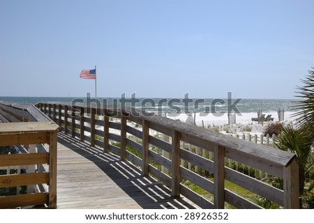 A boardwalk leading to the beach in Gulf Shores, AL. - stock photo