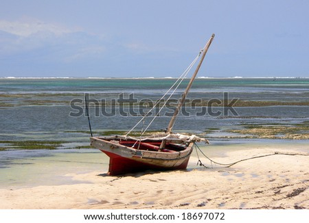 A boat at a beach in Kenya near Mombasa - stock photo