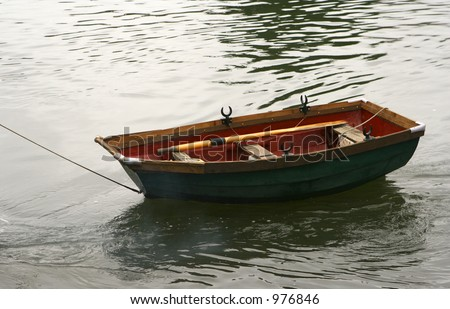 A boat being towed away on the river - stock photo