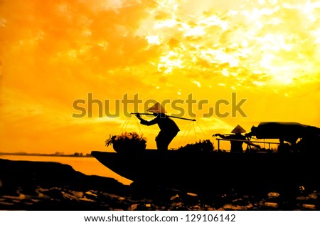 A boat carrying women brought flowers for sale - stock photo