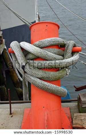 A boat line tied securely to a dock