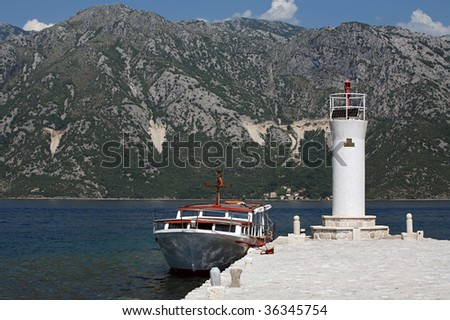 A boat moored at Our Lady of the Rocks in Kotor Bay, Montenegro. - stock photo