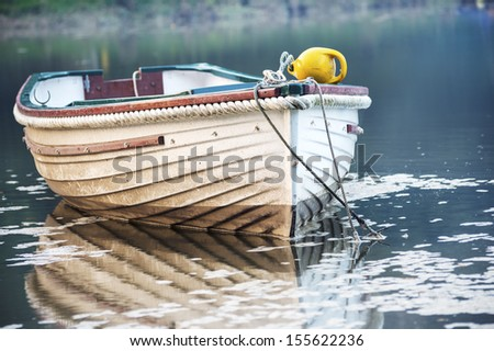 A boat moored on the Lerryn River in Cornwall - stock photo