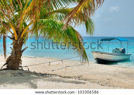 A Boat on a Beautiful Island in Belize - stock photo