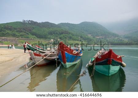 A boat on Lang Co Bay, a small town between Hue and Da Nang, Vietnam - stock photo