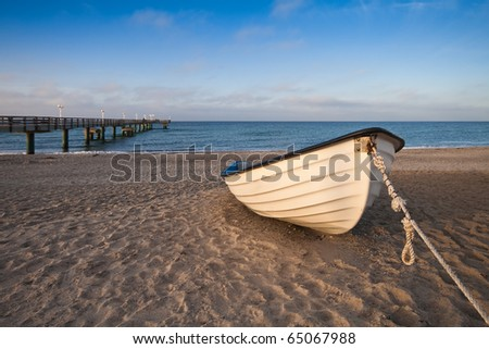 A boat on shore of the Baltic Sea. - stock photo
