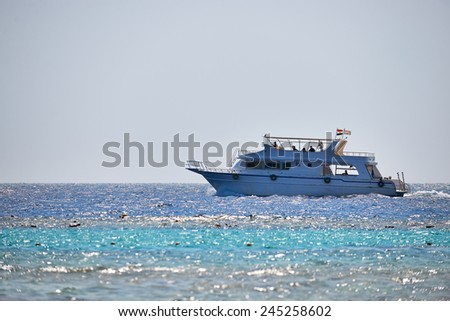A boat sailing in the Red sea, photographed in back light