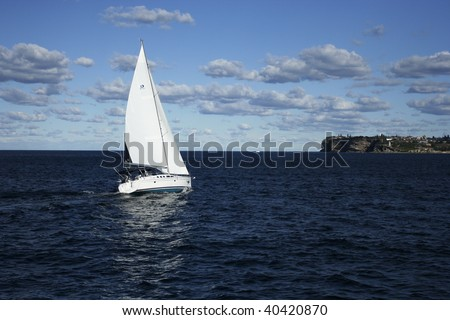 a boat sailing in the sea under a vast blue sky