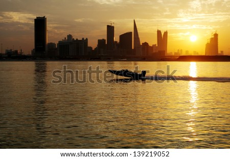 A boat speeding during sunset - stock photo