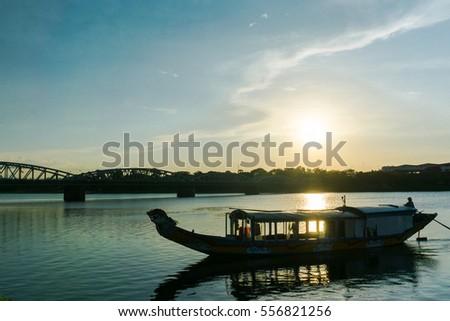 A boat station at Perfume River near Trang Tien bridge in sunset scene, Hue, Vietnam