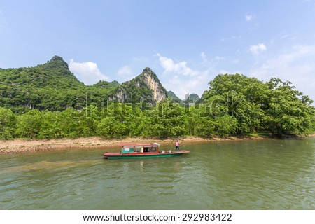 A boat travels through the magnificent scenic route along the Li river from Guilin to Yangshou.