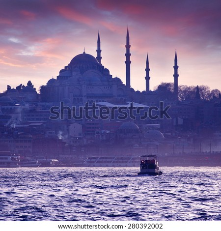 A boat trip on the Bosphorus at sunset. Istanbul at sunset. Evening Istanbul. Tourist trip in Turkey. - stock photo