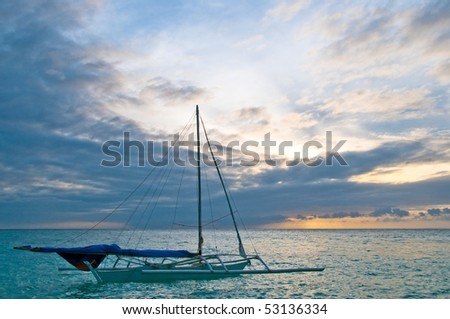 a boat waiting for the breeze