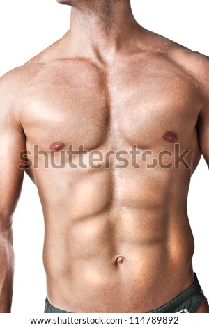a bodybuilder standing on a white background - stock photo