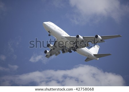 A Boeing 747 airliner coming in for landing on final approach
