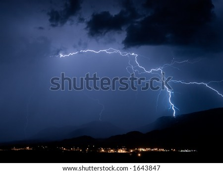A bolt of lightning clearly striking a mountain side