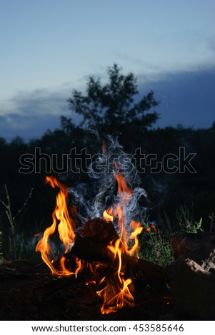 a bonfire at sunset