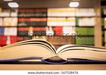 a book lying on the bookshelf in Library  - stock photo