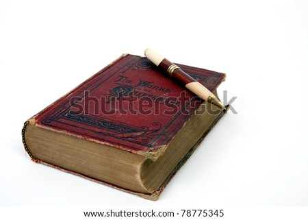 A book with a pen sitting on it, isolated.