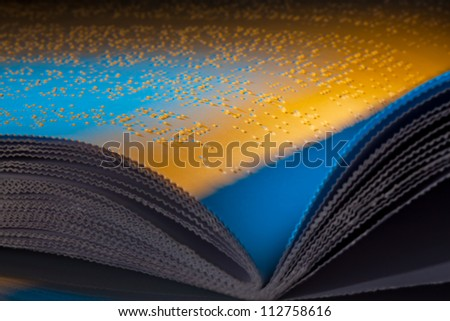 a book written in braille. braille for the blind. - stock photo
