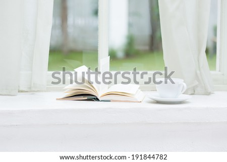 A books and coffee cup on furniture  - stock photo