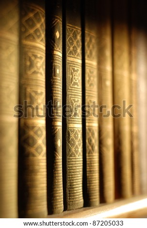 A bookshelf with books - stock photo