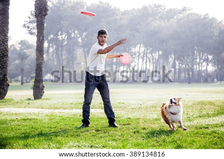 A Border Collie dog playing with its owner on a frisk morning in the park.