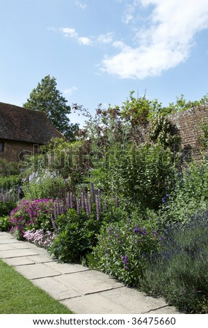 A border in an English cottage garden - stock photo
