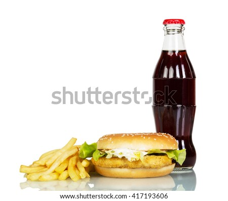 A bottle of cola, hamburger and french fries isolated on white background. - stock photo